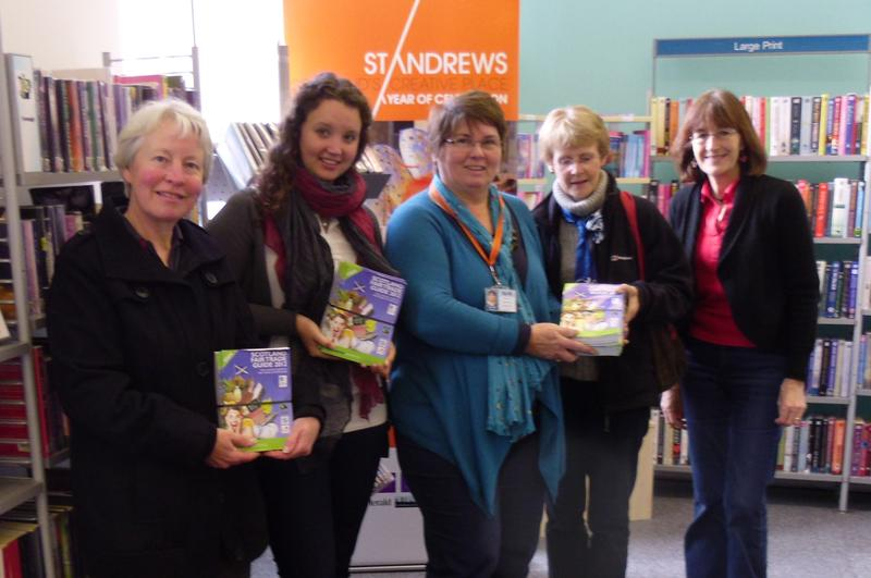 Handing over Fairtrade Scotland leaflets at the library